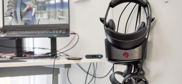 vr headset with immersive collaboration session running in the back
